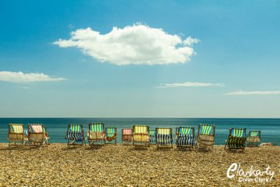 Deckchairs on a sunny day at Beer beach in Devon UK