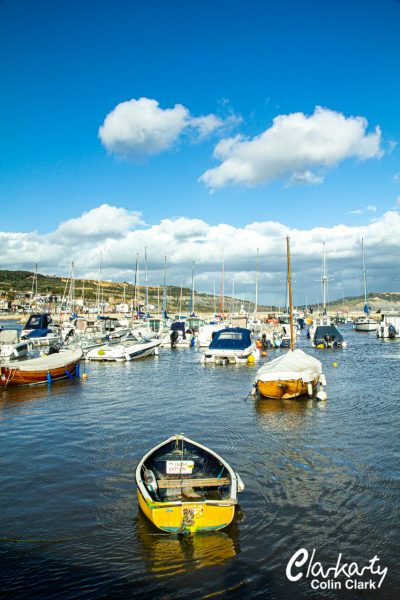 Lyme Regis harbour with boats